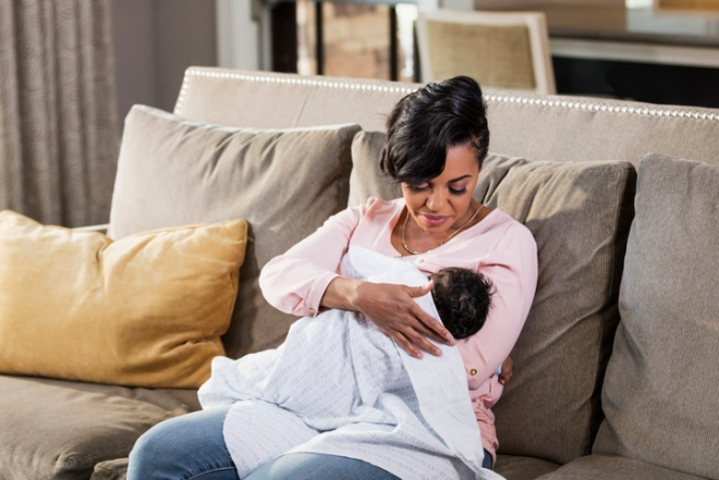 African-American mother nursing baby boy