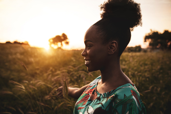 Woman with open arms breathing in the nature