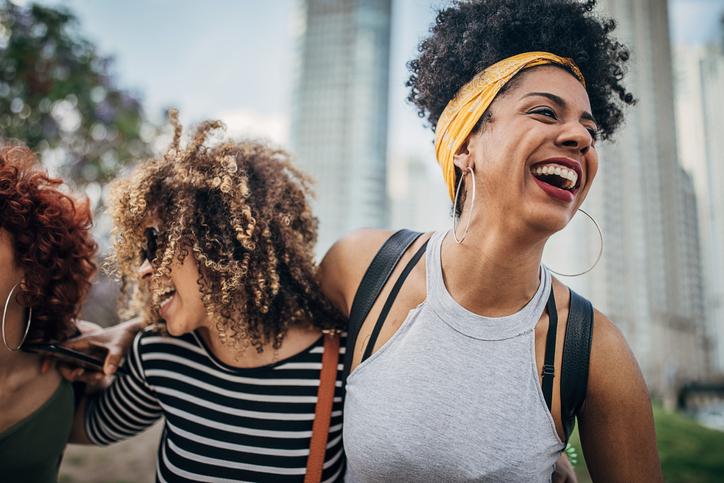 Happy women walking down the street