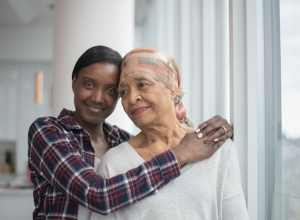 Daughter Hugging Her Mother with Cancer stock photo