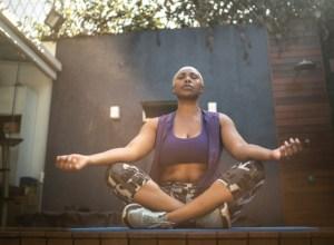 Woman meditating in the backyard