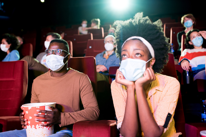 African-American couple watching a movie at the cinema during Covid-19 pandemic