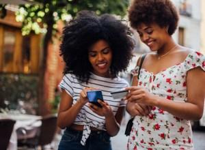 Girls shopping online on the street