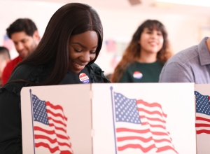 Mid-adult, African descent woman votes in USA election.