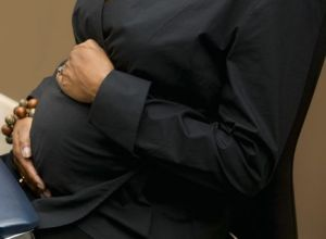 Pregnant Businesswoman Sitting at Computer