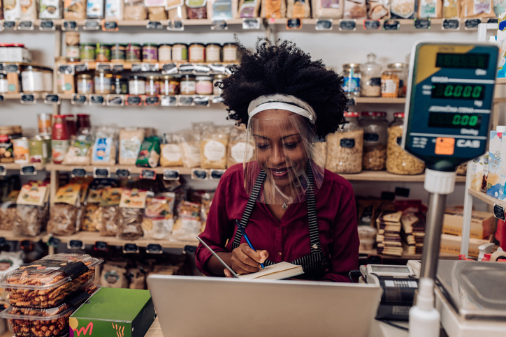 African-American owner of a grocery store running the business after reopening