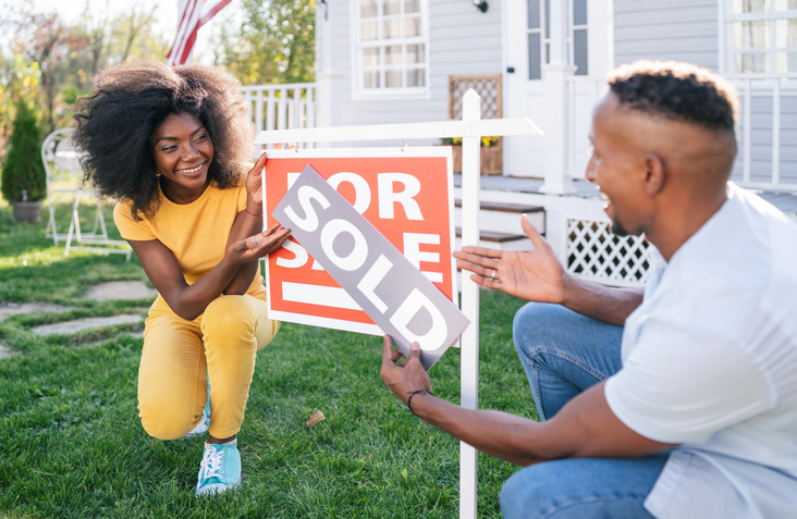 Young afro couple buying a new house