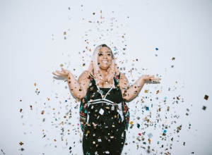 Generation Z Young Woman Celebrates With Confetti