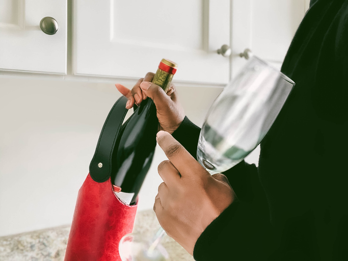 Woman Pulls Out Bottle of Red Wine