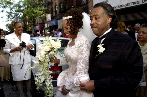 The Rev. Al Sharpton escorts his wife, Kathy Jordan Sharpton