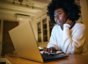 Woman works from home late at night