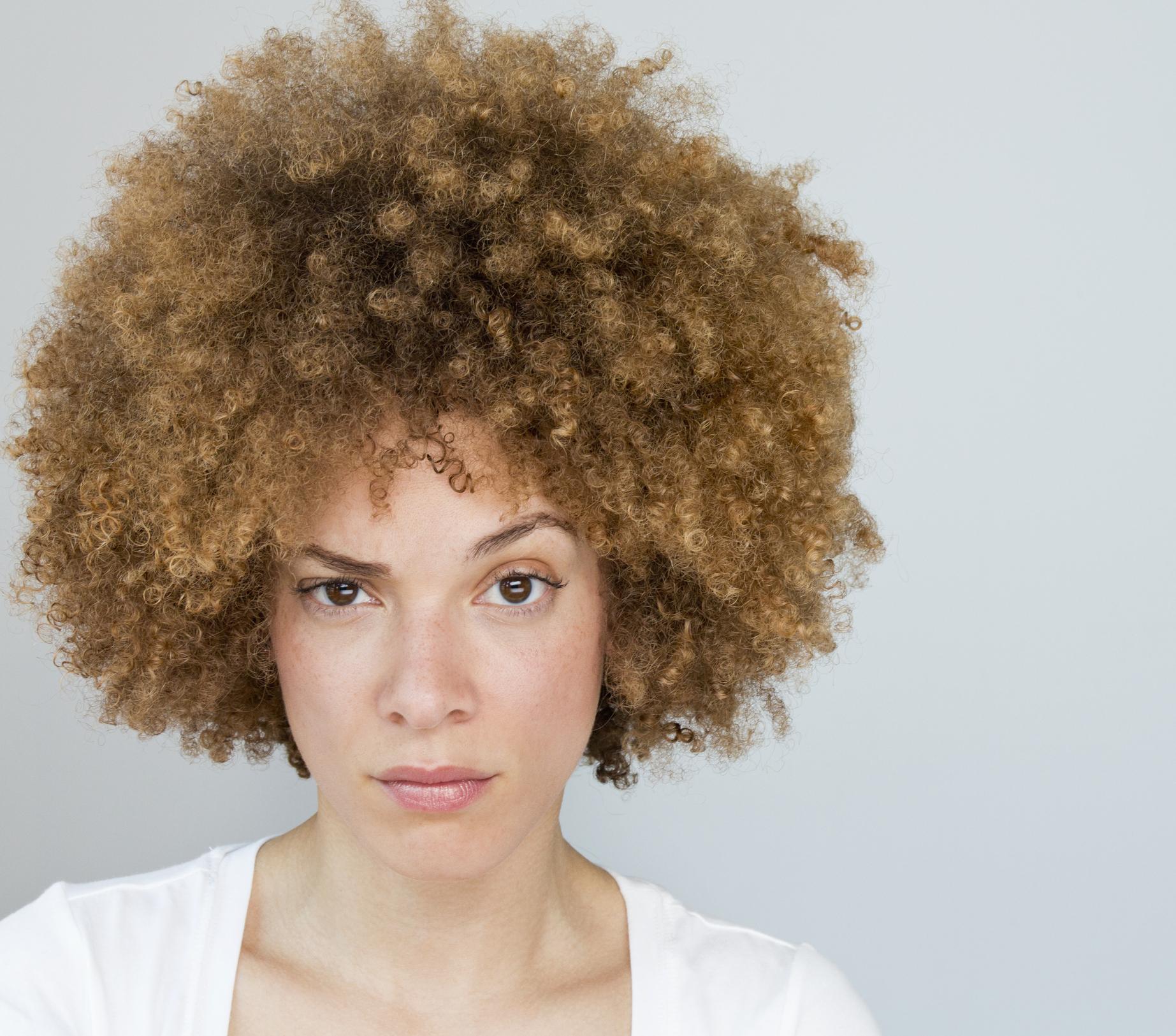 Black woman raising her eyebrow