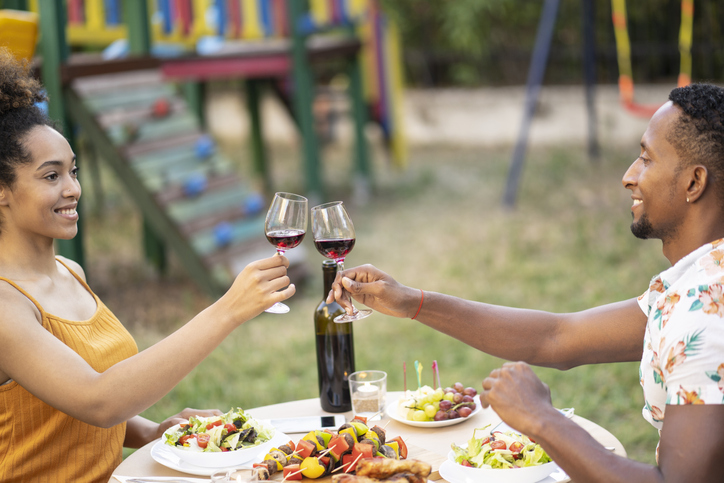 Couple having date in back yard in times of coronavirus conditions