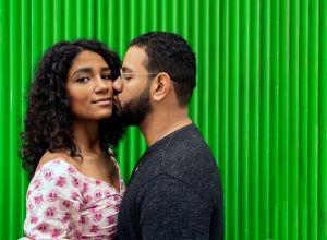 Man Kissing Woman Against Wall
