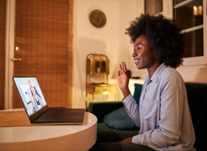 Businesswoman greeting her colleague on a video conference