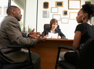African couple at lawyer's office