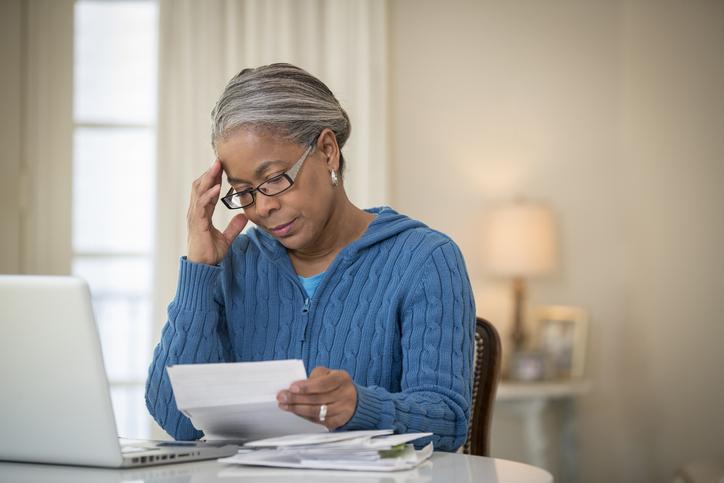 Senior African American woman paying bills
