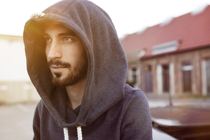 Portrait of bearded young man wearing hooded jacket