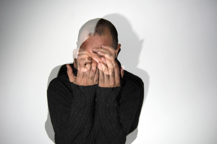 Man hiding face with his hands