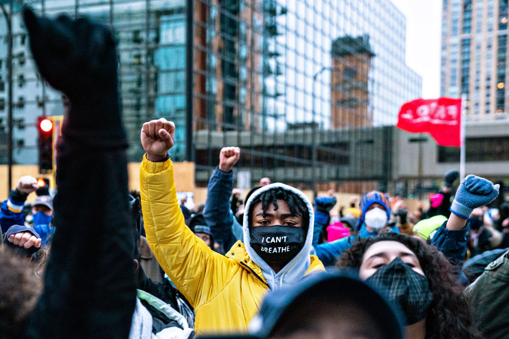 Protesters march around downtown Minneapolis near the courthouse calling for justice for George Flyod after closing arguments in the Chauvin trial has ended