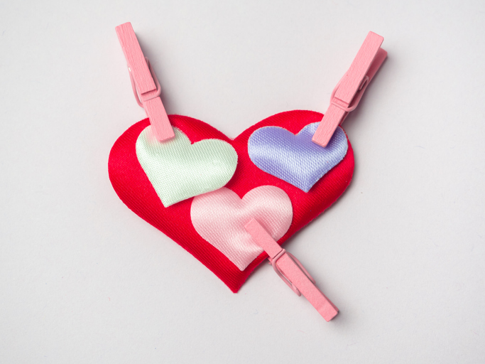Hearts attached with clothespins. Love concept