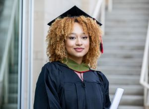 Portrait of young adult female at her college graduation