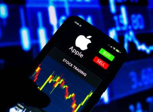 In this photo illustration the stock trading graph of Apple...
