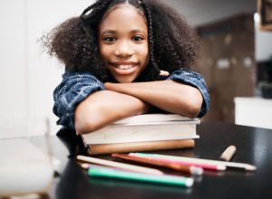 Portrait of a young girl doing a school assignment at home