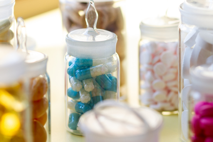 Pills in glass containers with caps