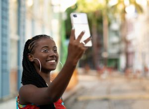 Beautiful afro woman taking selfie